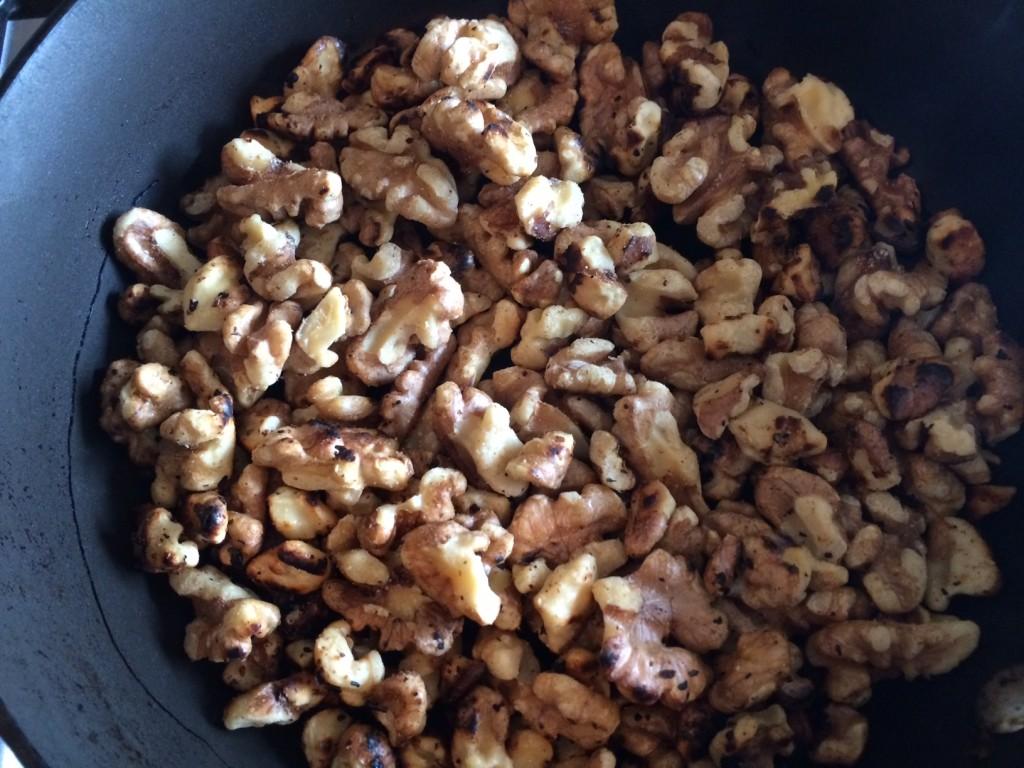 Roasting walnuts.
